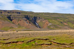 Summer Iceland Landscape with Waterfall and Bright Blue Sky Royalty Free Stock Photo