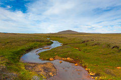 Summer Iceland Landscape with River and Bright Blue Sky Royalty Free Stock Image
