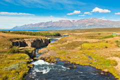 Iceland Landscape with River, Mountains and Bright Blue Sky Royalty Free Stock Images