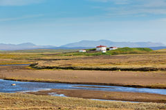 Iceland Landscape with River, Mountains and White Farmhouse Stock Images