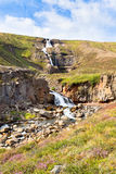 Summer Iceland Landscape with Waterfall and Bright Blue Sky Stock Photo