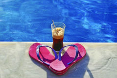 Summer icon - swimming pool - cold coffee pink thongs. Relax vacation concept - greek summer Stock Photos