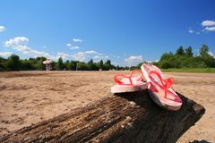 Summer II. Flip flops on a beach royalty free stock photography