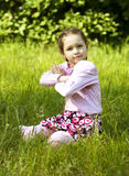 Summer image of little funny girl in park Royalty Free Stock Photos