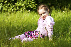 Summer image of little funny girl in park. Little funny girl in park, seeting, summer image stock photos