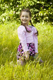 Summer image of little funny girl in park. Little funny girl in park, seeting, summer image royalty free stock photo