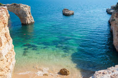 Free Summer In Algarve Coast, Portugal. Rocks In The Shoreline And Blue Water Royalty Free Stock Images - 44799039