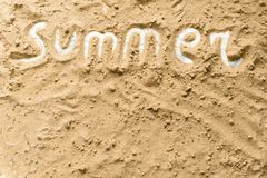 Summer inscription on a sandy background. The concept of travel Royalty Free Stock Photos
