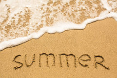 SUMMER inscription on the sea beach sand Royalty Free Stock Images