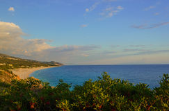 Summer Ionian Sea coastline view on the sunset with green bushes in front, Albania Stock Image