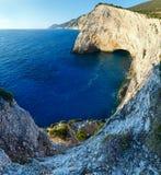 Summer Ionian Sea rocky coastline(Greece). Beautiful summer Ionian Sea rocky coastline with flowers on hill (Lefkada, Greece Stock Photography