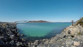 The summer island bridge in northern norway on a clear blue spring day. With calm moving waves and strong sunshine stock footage