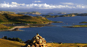 Summer Islands cairn, Coigach, Scotland. A visitors cairn, at the viewpoint above Altandhu, overlooking the glorious seascape of the Summer islands, on the west royalty free stock photos