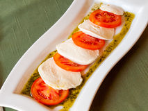 Summer Italian salad of red  tomatoes and mozzarella Stock Photography