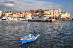 Summer in Italy. A boat with a cityscape of a little city(Pozzuoli) in southern Italy Stock Photos