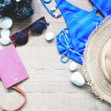 Summer items for women, beach summer collection on wood Royalty Free Stock Photos