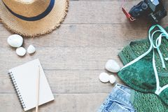 Summer items for women, beach summer collection on wood background Stock Images