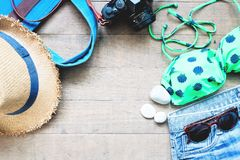 Summer items for women, beach summer collection on wood background Royalty Free Stock Photos