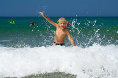 Summer joy. Little boy bathing on the sea Royalty Free Stock Images