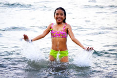 Summer Joy. Cute Asian girl enjoying the great water during summer royalty free stock photography