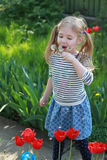 Summer joy - lovely girl blowing dandelion, happy child concept. Allergy season. Stock Photos