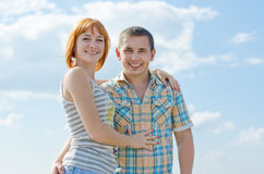 Summer joy. Man and women on a background of blue sky Stock Photography
