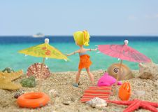 Summer joy - polly pocket girl doll having good time on beach Royalty Free Stock Photo