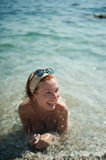 Summer joy of swimming in the sea. Summer joy bathing of beautiful young woman to the warm azure sea Stock Image