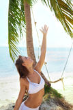 Young attractive woman Summer joy under the palm tree Stock Photos