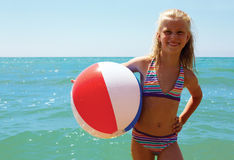 Summer joy - young girl enjoying summer. Girl with ball. Stock Images