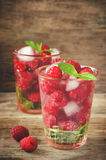 Summer juice with fresh raspberries mint and ice in a glass Royalty Free Stock Photo