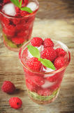 Summer juice with fresh raspberries mint and ice in a glass Royalty Free Stock Image
