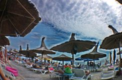 Summer 2014 on Jupiter beach - Constanta, Romania. People on the beach. Image was caught with a wide fish eye smartphone lens and edited with a free app Stock Photo
