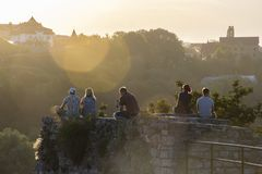 Sunset   on the castle in Kamianets-Podilskyi royalty free stock photos
