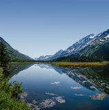 Summer on the Kenai. Mountains frame a perfectly still Alaskan Lake Stock Images