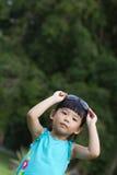 Summer kid. Portrait of little Asian child in garden during summertime Stock Image