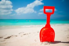 Summer kid's beach toy in the white sand Stock Photos