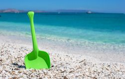 Summer kid's beach toy in the white sand Stock Image
