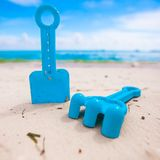Summer kid's beach toys in the white sandy beach Royalty Free Stock Images