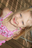 Summer Kids. Beautiful little blond girl in her bathing suit out at the lake Royalty Free Stock Photos