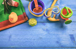 Summer kids vacation concept on blue background - top view Stock Image