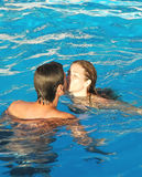 Summer Kiss. Happy couple kissing in pool Stock Images