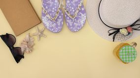 Summer kit and woman`s accessories for the beach on the yellow background - Stop motion stock video