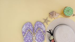 Summer kit and woman`s accessories for the beach on the yellow background - Stop motion stock video footage