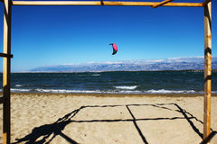 Summer kiteboarding. Beautiful sand beach and kitesurfer in the background stock images