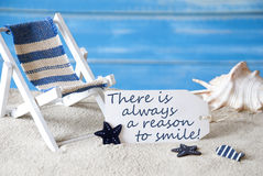 Summer Label With Deck Chair And Quote Always Reason Smile. Summer Label With English Quote There Is Always A Reason To Smile . Blue Wooden Background. Card With Stock Photo
