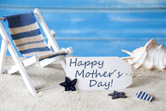 Summer Label With Deck Chair And Text Happy Mothers Day. Summer Label With English Text Happy Mothers Day. Blue Wooden Background. Card With Holiday Greetings Royalty Free Stock Photos