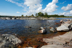 Summer on Ladoga. Small stony islet in Ladoga lake Stock Photography
