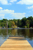 Summer Lake. Pier on a beautiful summer day on this colorful lake Stock Photos