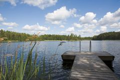 Summer Lake. Swimming pier at a lake in Finland Royalty Free Stock Images